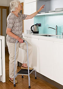 Lady standing on the Ideaworks Handy Support Stool