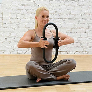woman pushing on pilates circle