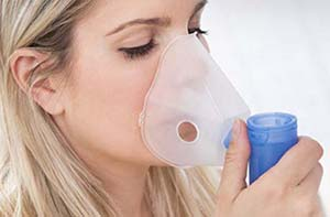 woman using nebuliser