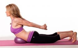 Jill Miller demonstrating Yoga Tune Up Coregeous core exercises